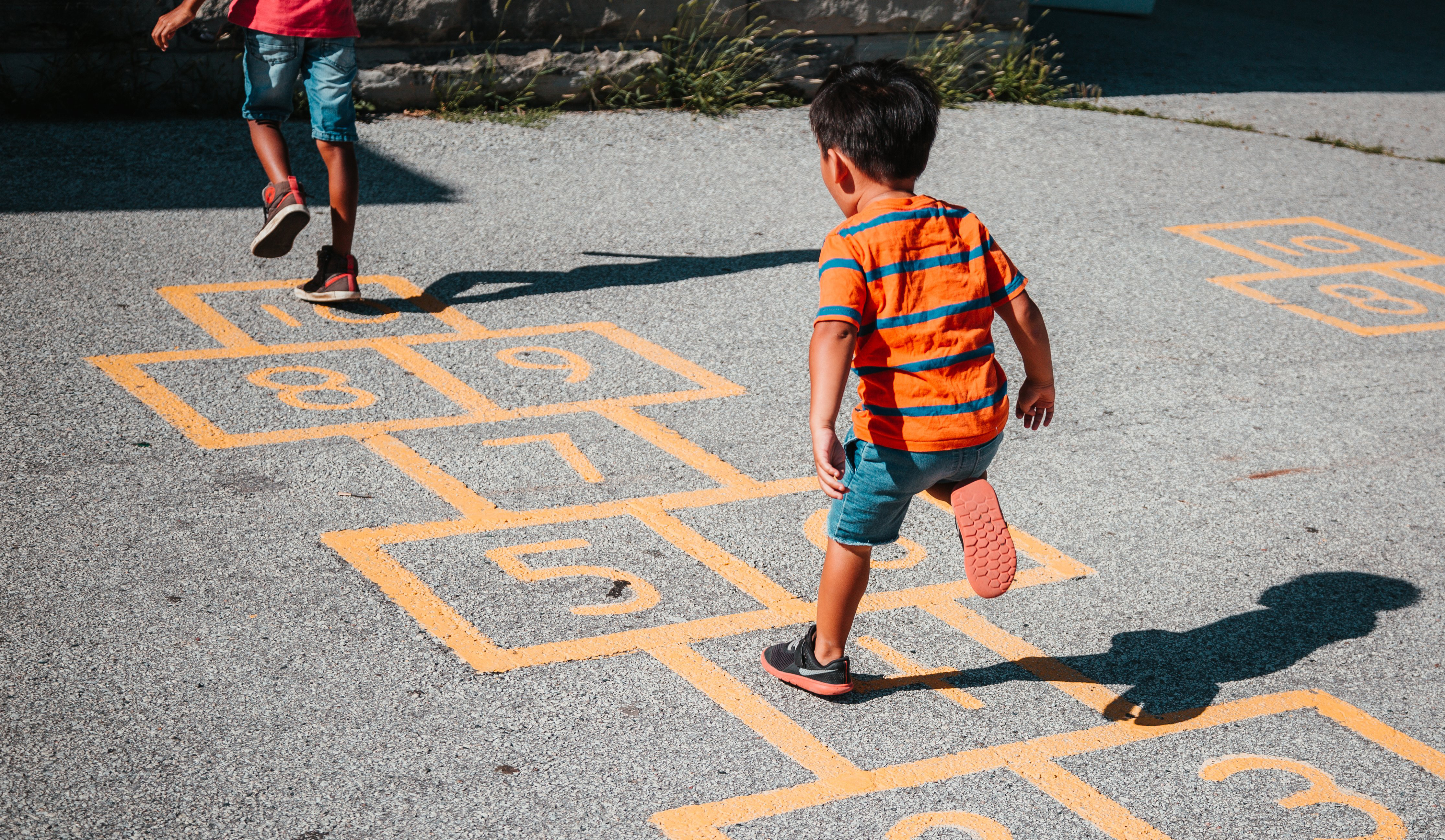 cropped_playing-hopscotch-together