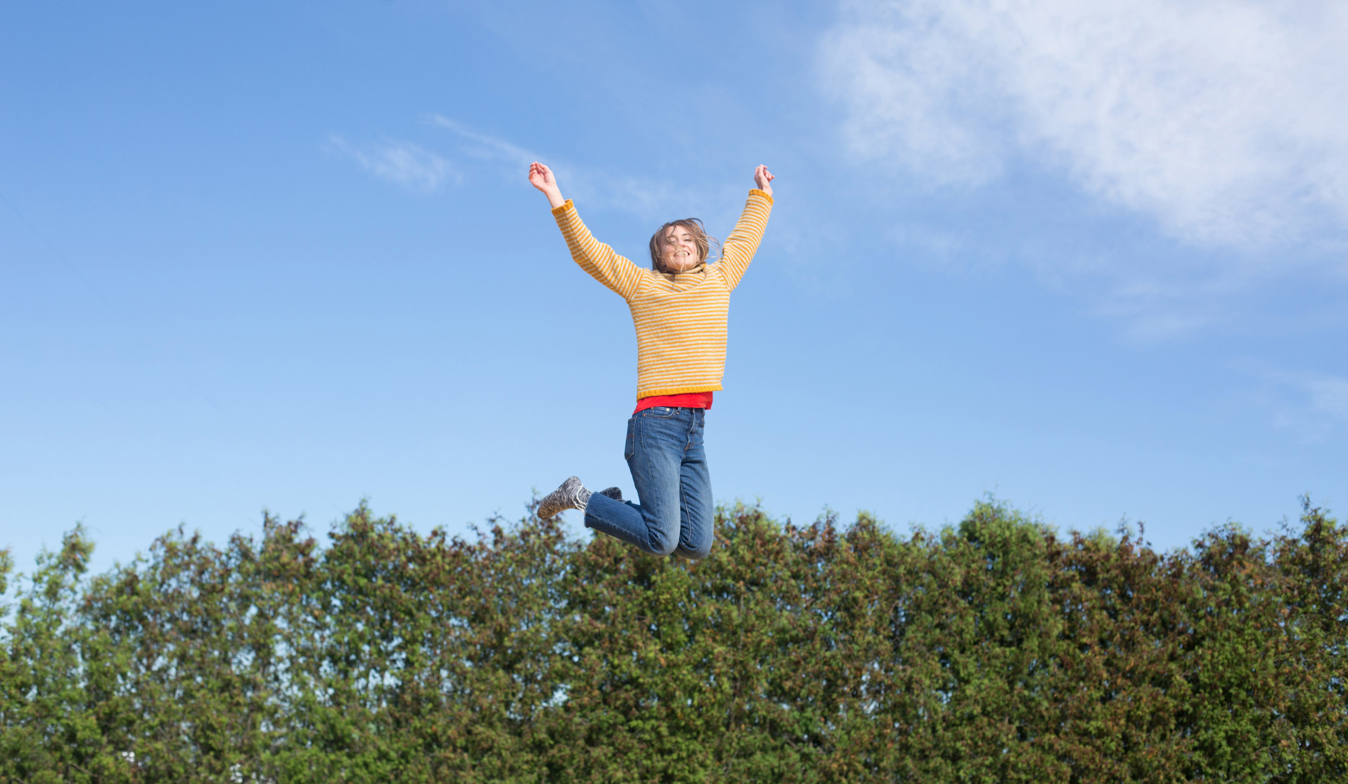 cropped_happy-woman-jumps-on-trampoline