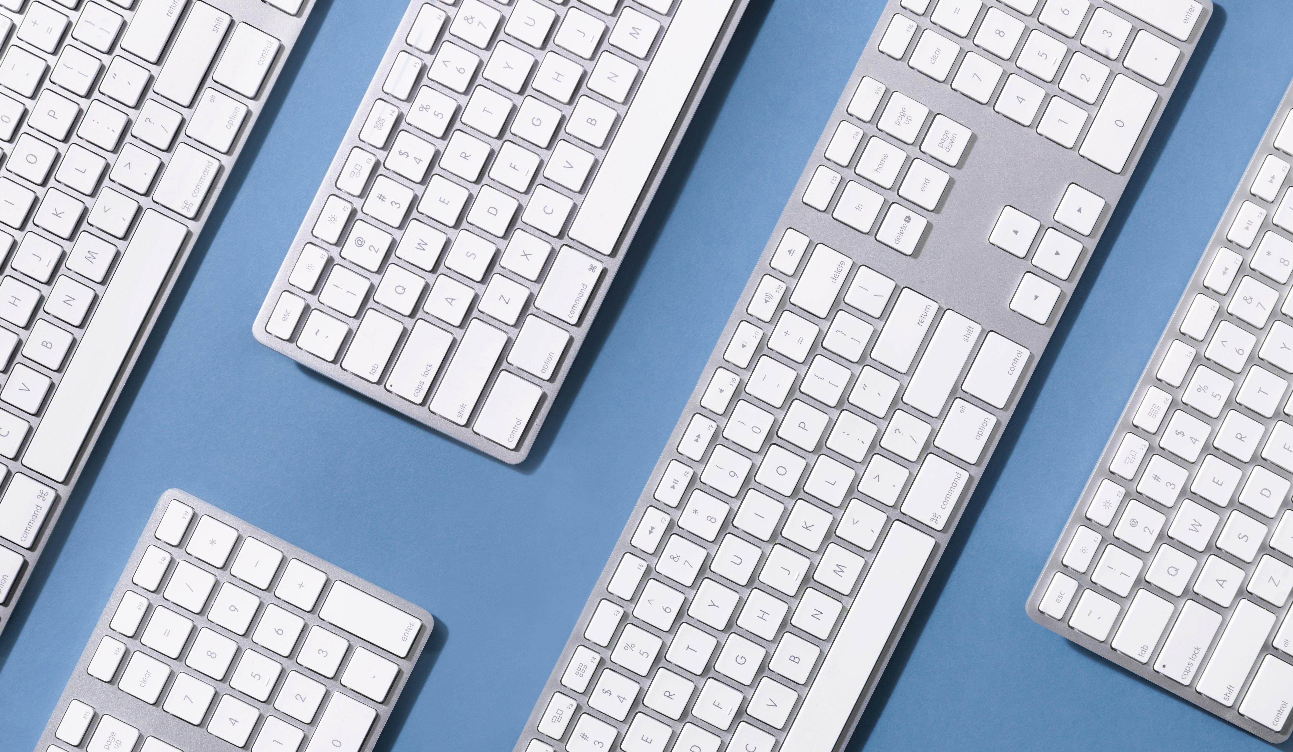 cropped_keyboards-on-blue-surface