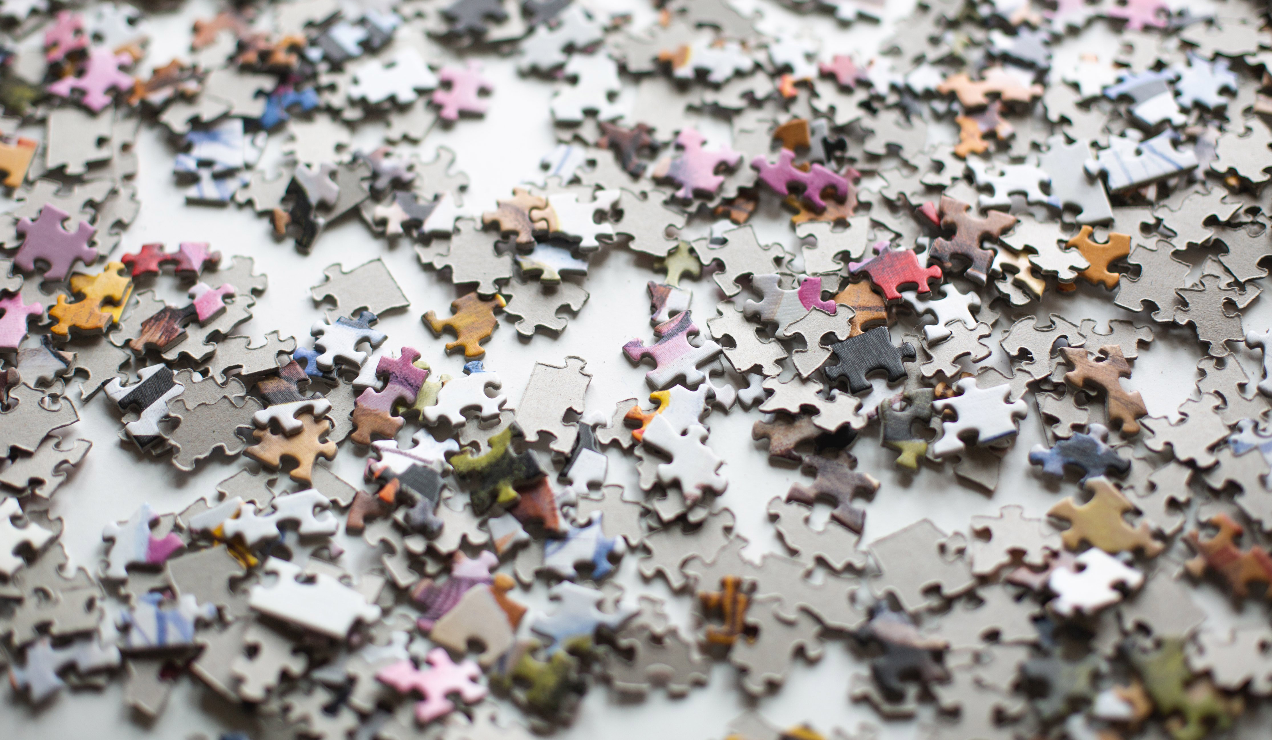 cropped_puzzle-pieces-scattered-across-a-surface