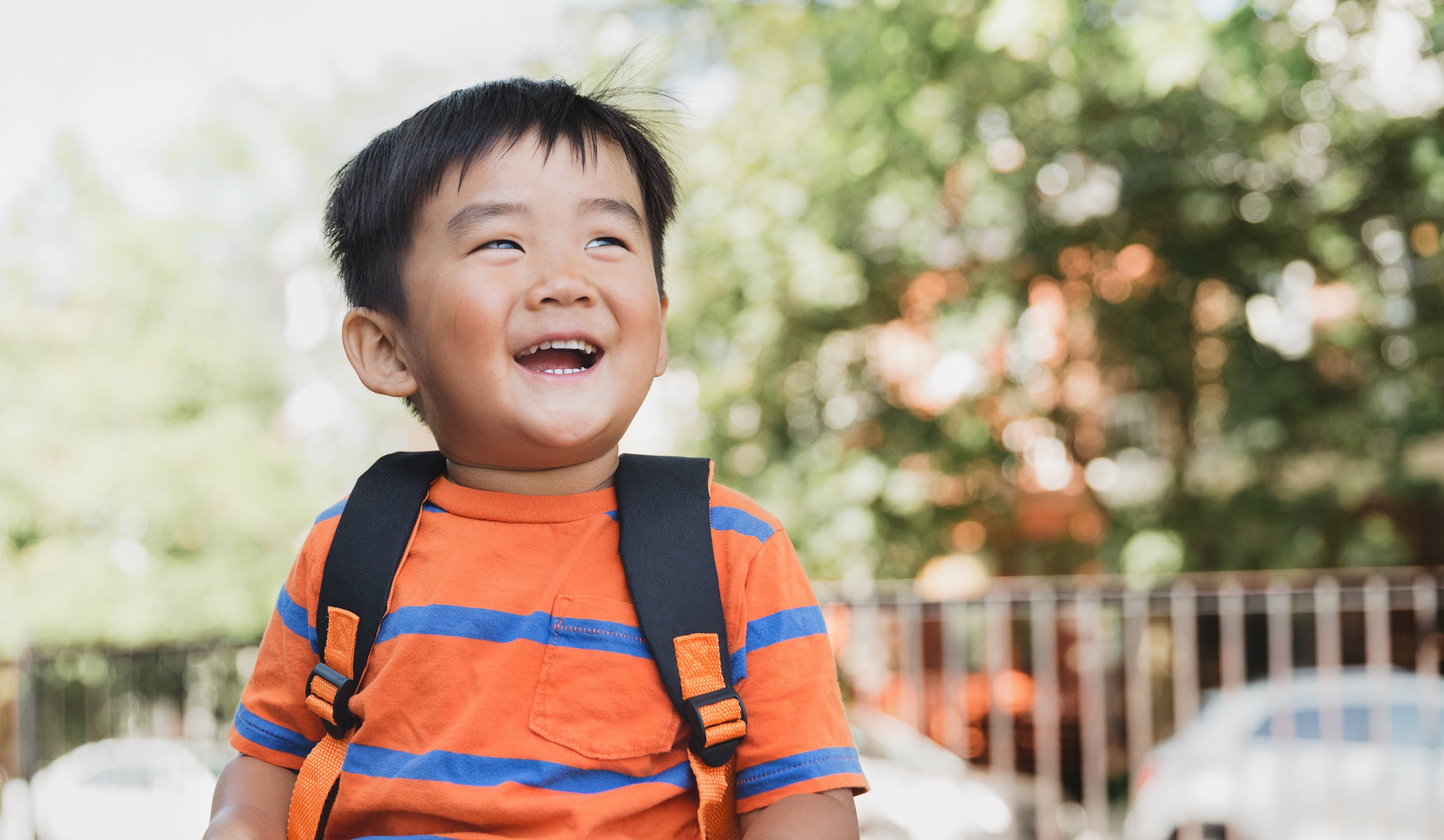 cropped_school-child-giggles-in-the-sun