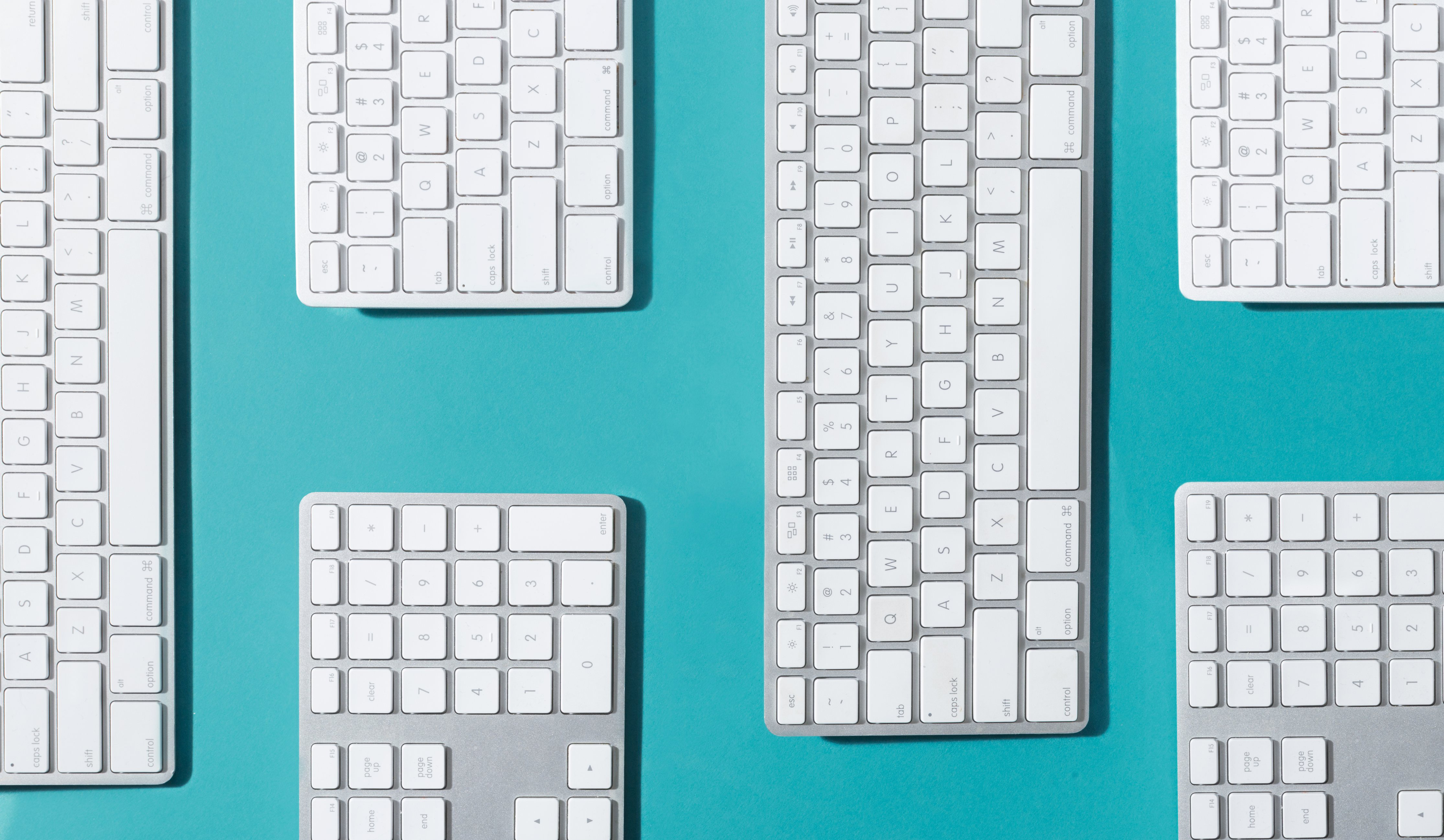 cropped_silver-and-white-keyboards-flat-lay