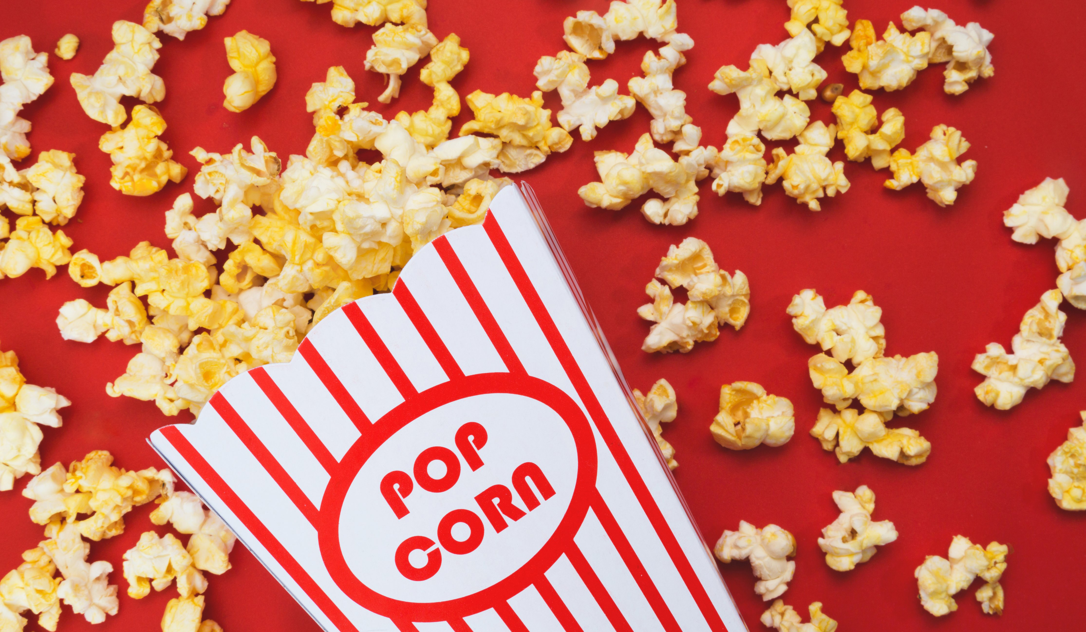 cropped_spilled-popcorn-on-a-red-background