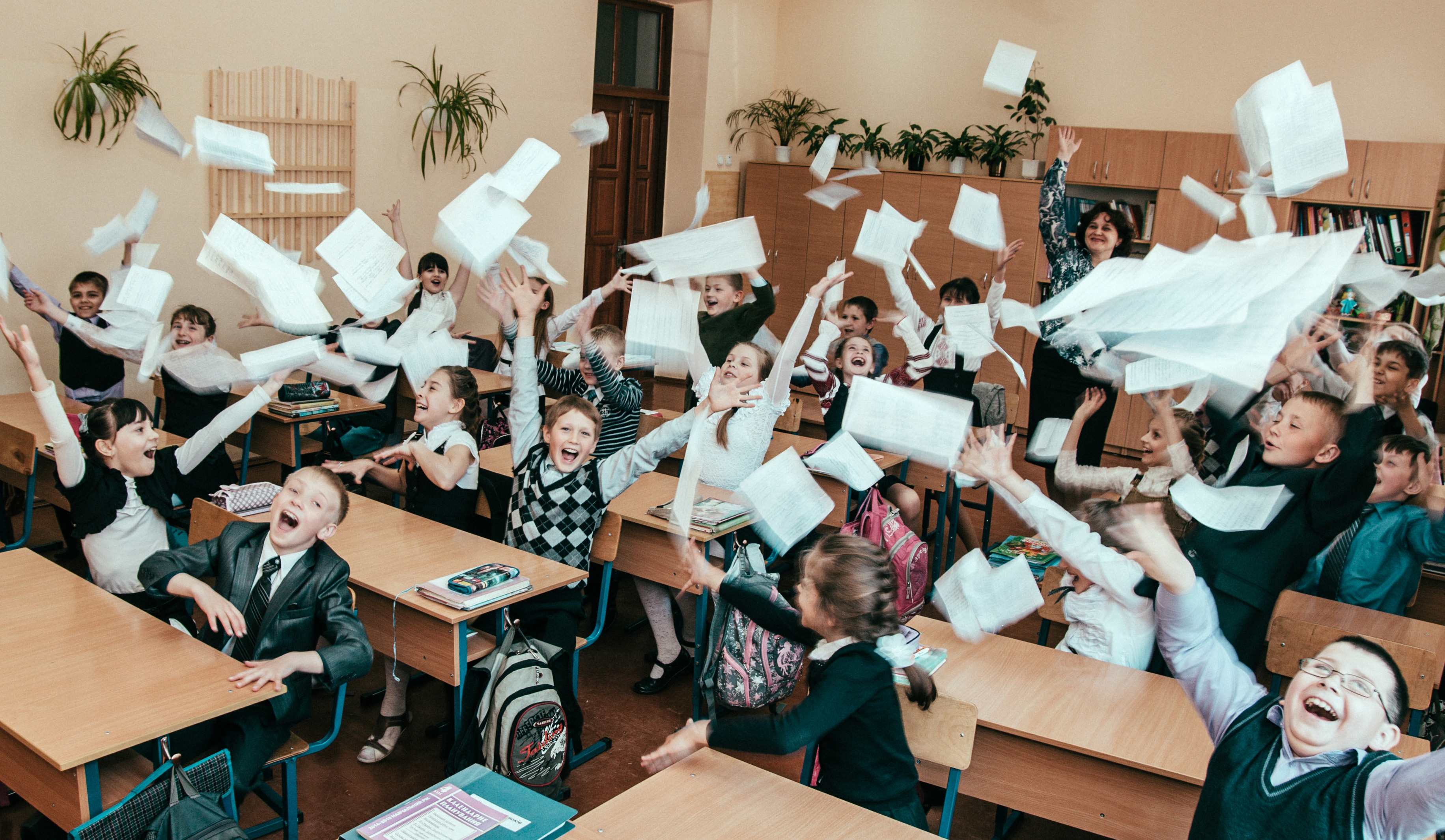 cropped_students-throw-paper-in-classroom