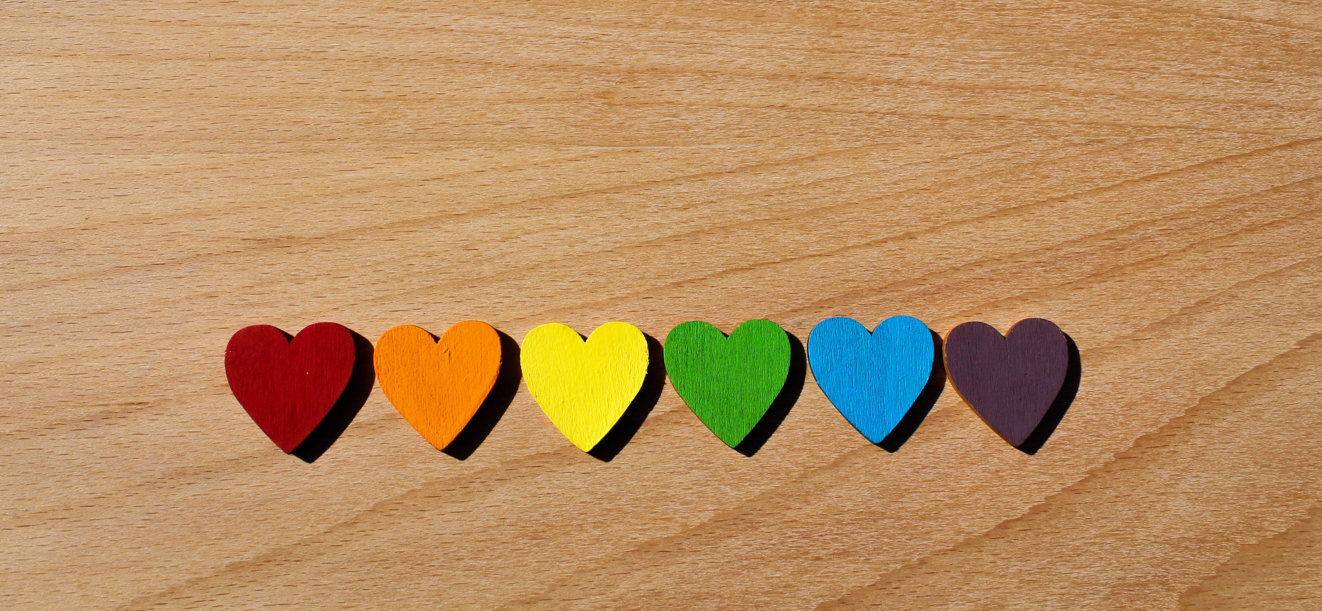 rainbow-wooden-hearts-lined-up-on-oak-table-1